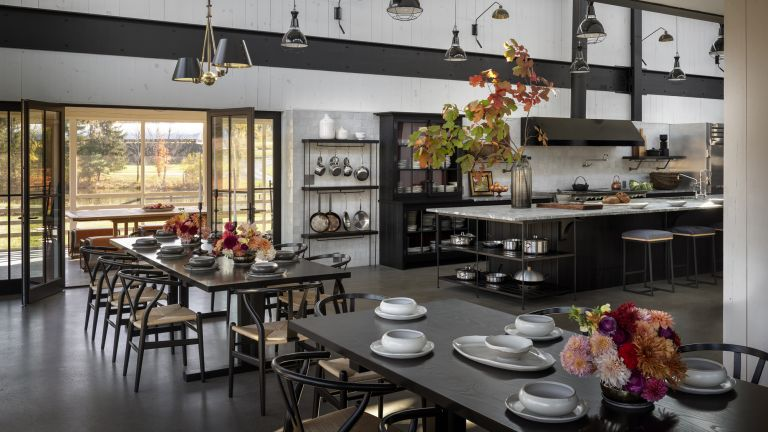 A large dining area with double height ceilings in a barn conversion