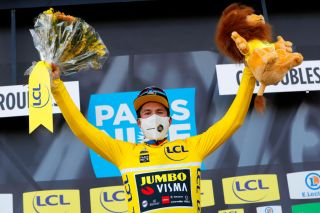 CHIROUBLES FRANCE MARCH 10 Podium Primoz Roglic of Slovenia and Team Jumbo Visma Yellow Leader Jersey Celebration during the 79th Paris Nice 2021 Stage 4 a 1875km stage from ChalonSurSane to Chiroubles 702m Mask Covid safety measures Trophy Flowers Lion Mascot ParisNice on March 10 2021 in Chiroubles France Photo by Bas CzerwinskiGetty Images