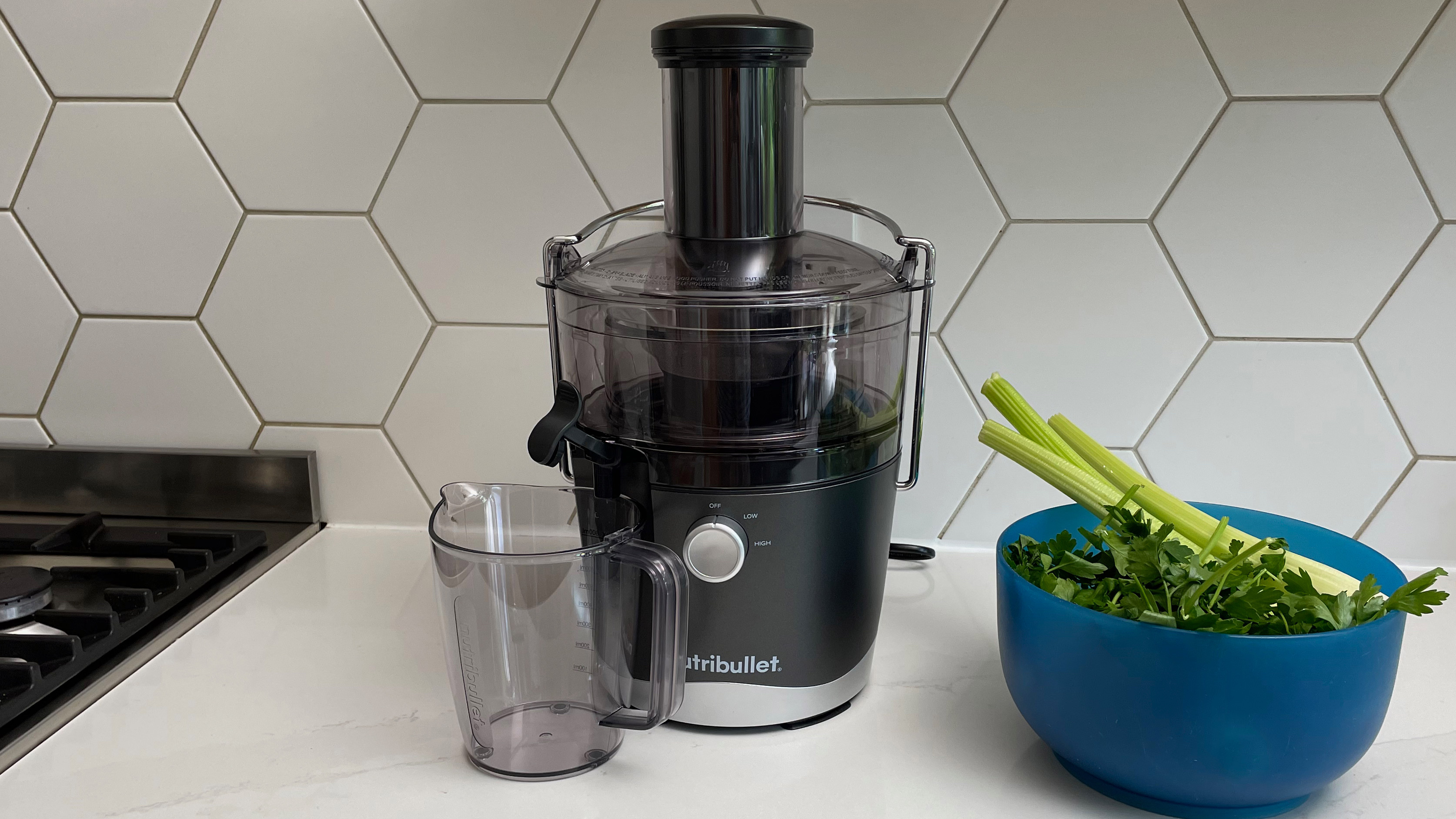 Nutribullet Juicer on a kitchen countetop with a bowl of celery
