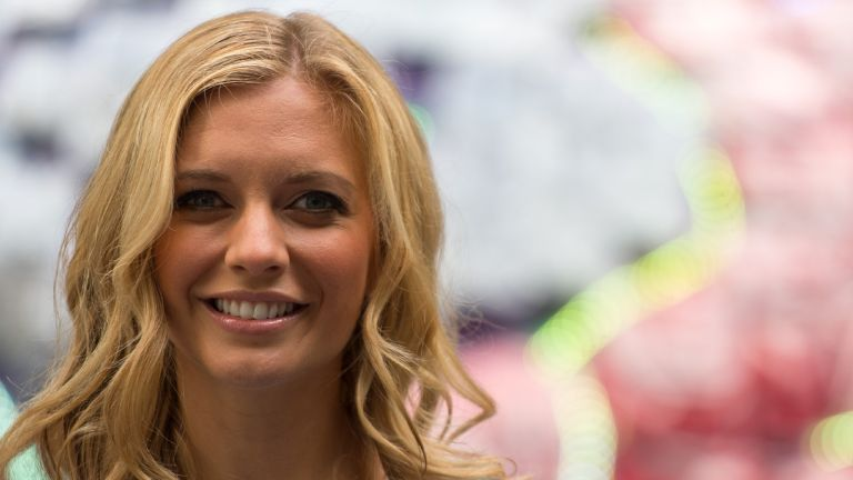 Rachel Riley poses next to a giant brain made of fresh British berries to promote the fact that berries could help to improve memory and concentration at New Street Square on July 28, 2016 in London, England.