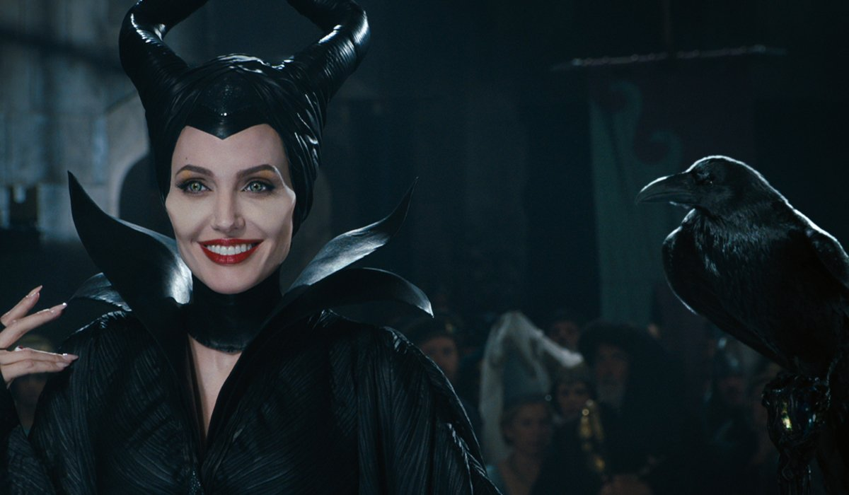 Maleficent Angelina Jolie smiles with her raven on hand