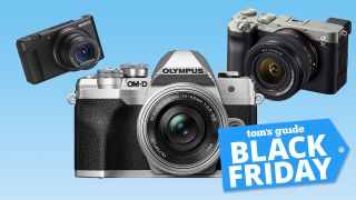 """Three cameras against a blue background. A label with white text on a blue background reads """"Tom's Guide Black Friday"""""""