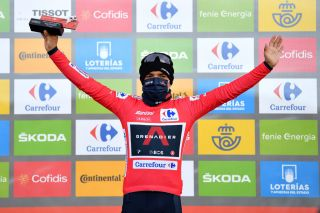 ALTODELANGLIRU SPAIN NOVEMBER 01 Podium Richard Carapaz of Ecuador and Team INEOS Grenadiers Red Leader Jersey Celebration Trophy Mask Covid safety measures during the 75th Tour of Spain 2020 Stage 12 a 1094km stage from Pola de Laviana to Alto de lAngliru 1560m lavuelta LaVuelta20 La Vuelta on November 01 2020 in Alto de lAngliru Spain Photo by Justin SetterfieldGetty Images
