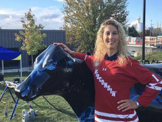 Jolanda Neff received a Univ. of Wisconsin hockey jersey for winning the C2 race at Trek CX Cup