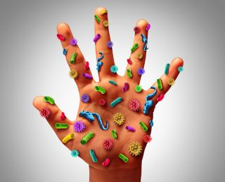 An artist's image of germs on the human hand.
