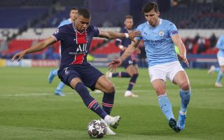 Kylian Mbappe of Paris Saint-Germain is challenged by Manchester City's Ruben Dias on April 28 in their Champions League semifinal first-leg match.