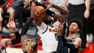 JaMychal Green #0 of the Denver Nuggets is fouled by Robert Covington #23 of the Portland Trail Blazers in the third quarter during Round 1, Game 4 of the 2021 NBA Playoffs at Moda Center on May 29, 2021 in Portland, Oregon.