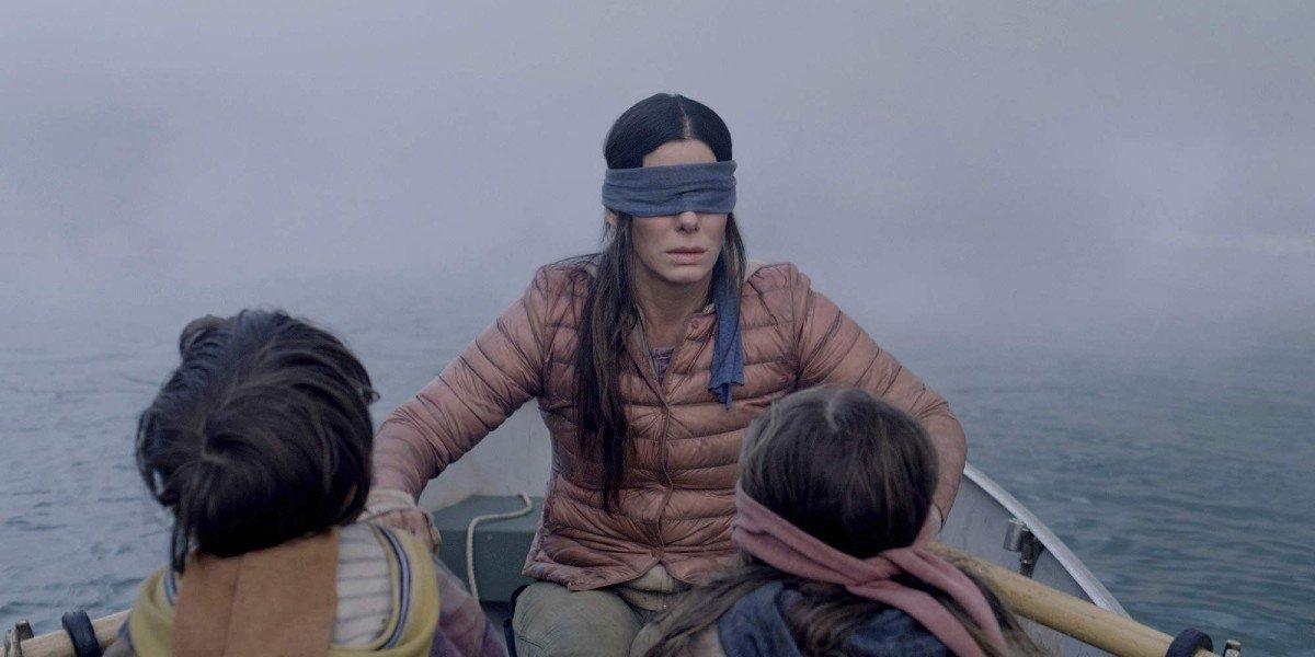 Vivien Lyra Blair, Julian Edwards, and Sandra Bullock in Bird Box