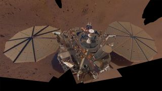 This image, the second selfie captured by NASA's InSight Mars lander, is a mosaic of 14 photos taken between March 15 and April 11, 2019.