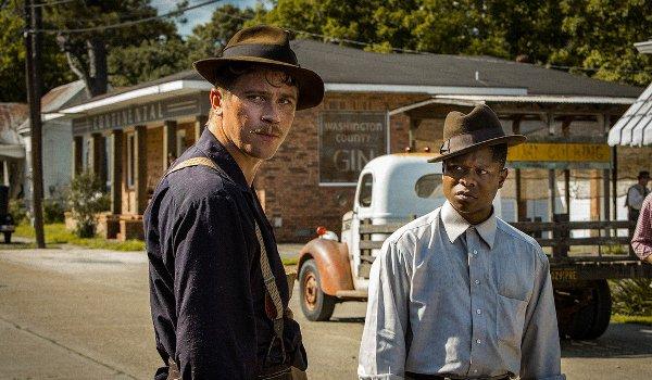 Mudbound Garrett Hedlund Jason Mitchell eyeing something suspicious