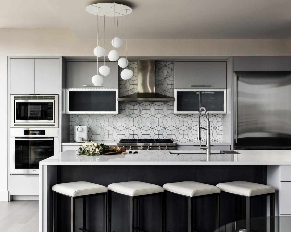Explore this modern condo with a beautifully balanced interior scheme