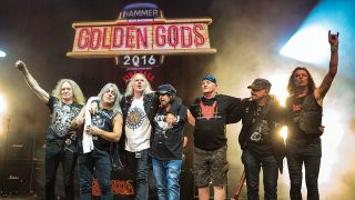 A photograph of Saxon and Motorhead together on stage at the Golden Gods 2016