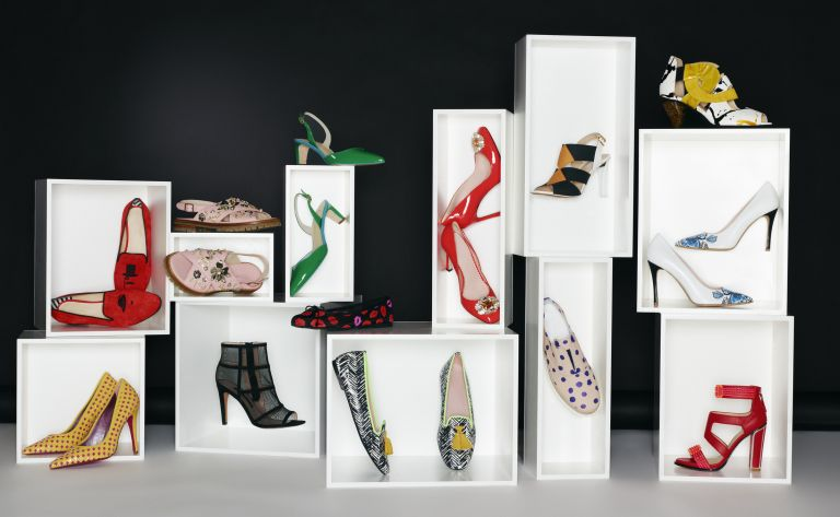 Lots of pretty shoes displayed in white boxes against a black background