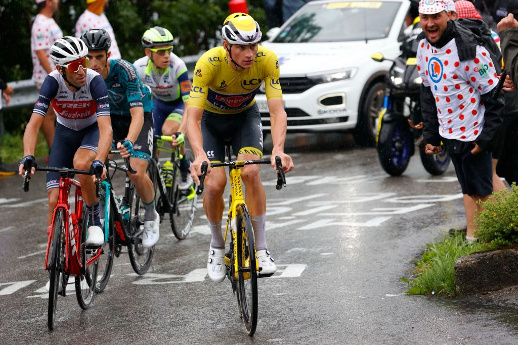 Team Alpecin Fenix Mathieu van der Poel of Netherlands R wearing the overall leaders yellow jersey rides during the 8th stage of the 108th edition of the Tour de France cycling race 150 km between Oyonnax and Le GrandBornand on July 03 2021 Photo by Thomas SAMSON AFP Photo by THOMAS SAMSONAFP via Getty Images