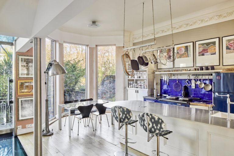 Open plan kitchen with island and blue tiled splashback