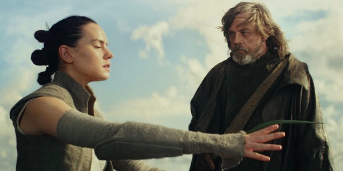 Star Wars: The Last Jedi Rey tries to feel the force, while Luke stands by with a frond
