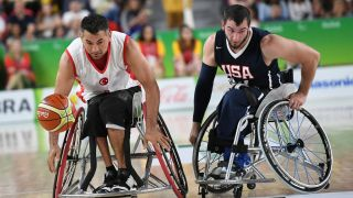 Two men playing wheelchair basketball at the Paralympics
