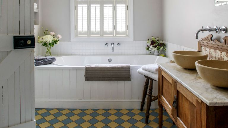 white bathroom ideas with colorful floor tiles