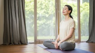 Can yoga fix your posture? image shows woman doing yoga breathing exercises