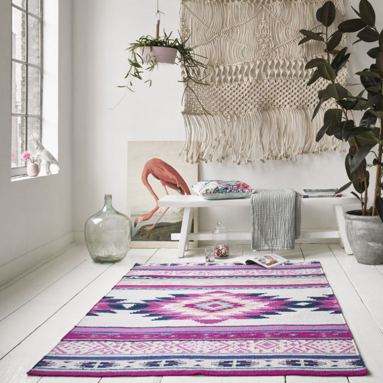 Living room with tribal-inspired pink rug