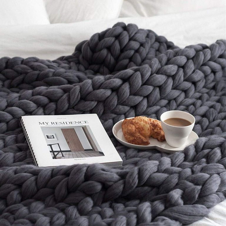Chunky knit throw from Amazon on bed