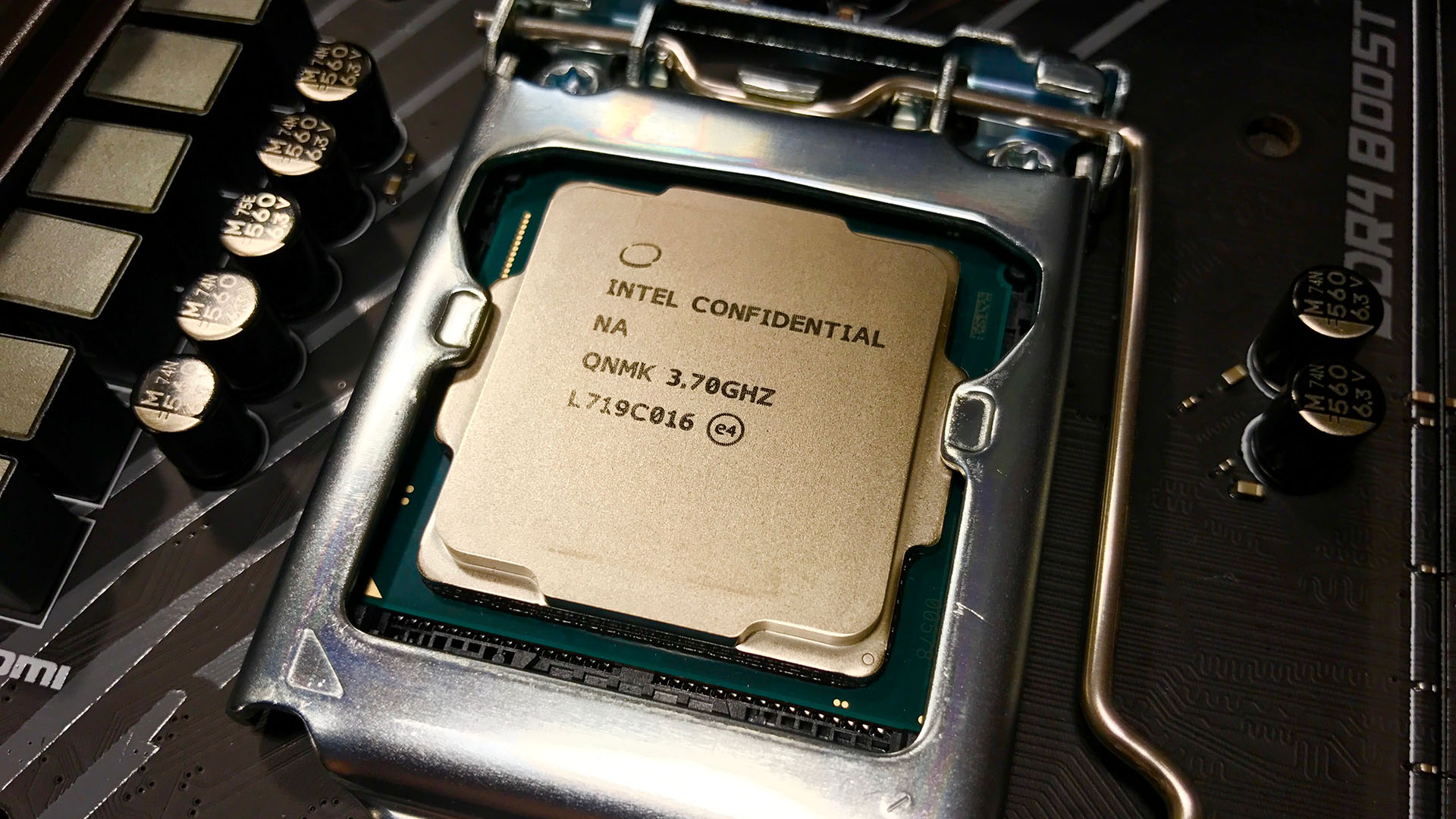Photograph of a naked CPU in a motherboard socket.