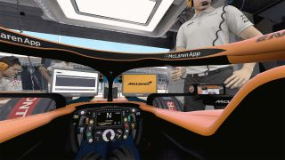 An image of the interior of an F1 garage and McLaren cockpit.