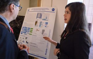 A young professional discussing their project during the 2019 Annual Earth Science Applications Showcase, held on Aug. 1, 2019, at NASA Headquarters in Washington, DC..