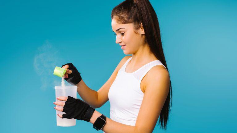 Woman mixing a protein powder shake