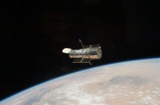 The Hubble Space Telescope, an icon of astronomy, is seen in orbit in May 2009 by the crew of NASA's STS-125 mission. The space telescope is the star of Hubble@25, a new exhibit at the Intrepid Sea, Air and Space Museum in New York City.