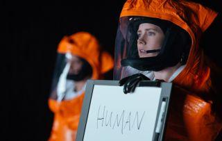 Arrival Amy Adams orange hazmat suit