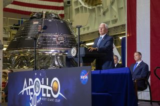 Vice President Mike Pence talks about the 50th anniversary of Apollo 11's lunar landing near the NASA's Artemis 1 Orion (background) on July 20, 2019 at the Kennedy Space Center's Neil Armstrong Operations & Checkout Building.