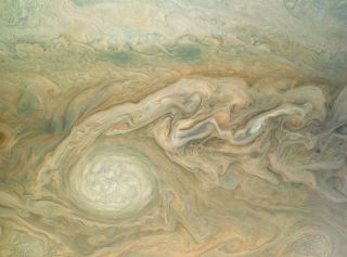 Jupiter's Little Red Spot takes center stage in this enhanced color photo from NASA's Juno spacecraft in orbit around the planet. The image was taken Feb. 2, 2017 (and released May 18) and was processed by citizen scientist Bjorn Jonsson using data from J