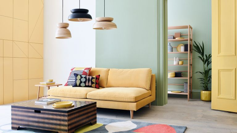 colour blocking wall ideas: Modern living room with yellow sofa, yellow and green walls and vibrant rug with furniture from Habitat