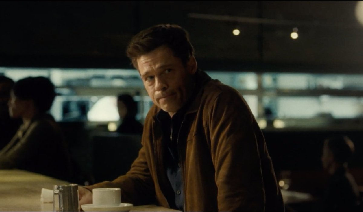 Ad Astra Brad Pitt sitting at a counter with coffee