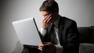 Sad business man and laptop