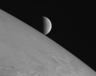 The icy moon Europa rising above Jupiter's cloud tops. The picture was one of a handful of the Jupiter system that New Horizons took primarily for artistic, rather than scientific, value.