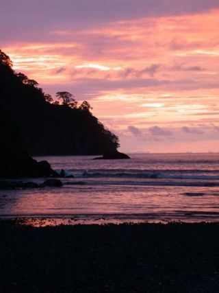Sunset in the Pacific: Cocos Island is uninhabited, but the waters that surrounded the tiny island are rich with a dazzling array of ocean life.