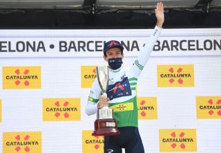 BARCELONA SPAIN MARCH 28 Podium Adam Yates of United Kingdom and Team INEOS Grenadiers Green Leader Jersey Celebration during the 100th Volta Ciclista a Catalunya 2021 Stage 7 a 133km stage from Barcelona to Barcelona Mask Covid safety measures Trophy VoltaCatalunya100 on March 28 2021 in Barcelona Spain Photo by David RamosGetty Images