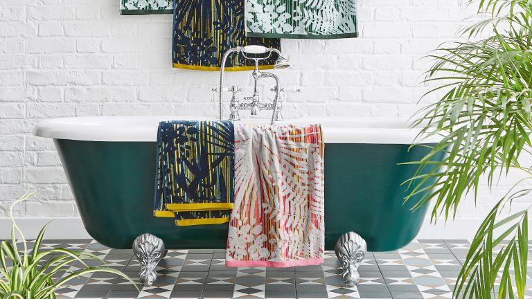 Eucalyptus shower bundle trend, tiled bathroom with large racing green free standing tub