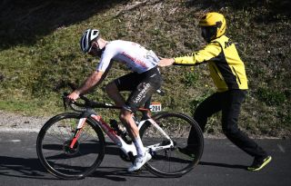 Team Sunweb rider Switzerlands Marc Hirschi is pushed forward after crashing during the 18th stage of the 107th edition of the Tour de France cycling race 168 km between Meribel and La Roche sur Foron on September 17 2020 Photo by Marco BERTORELLO AFP Photo by MARCO BERTORELLOAFP via Getty Images