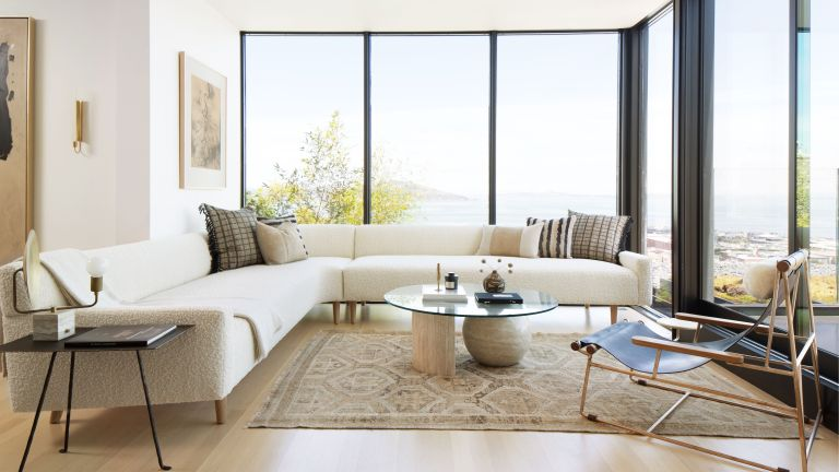 An example of minimalist living room ideas with an L-shaped sofa and wooden floor