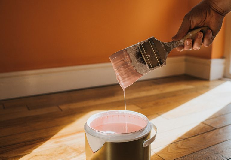 Painting over orange wallpaper with pink