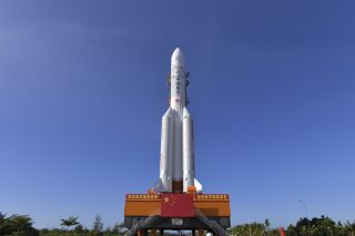 The Chinese Long March-5 rocket carrying China's Tianwen-1 Mars mission rolls out to the launch pad on July 17, 2020.