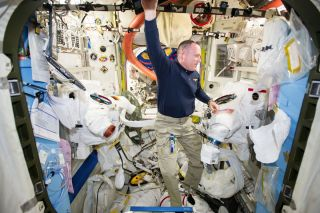 Wilmore Prepares U.S. Spacesuits