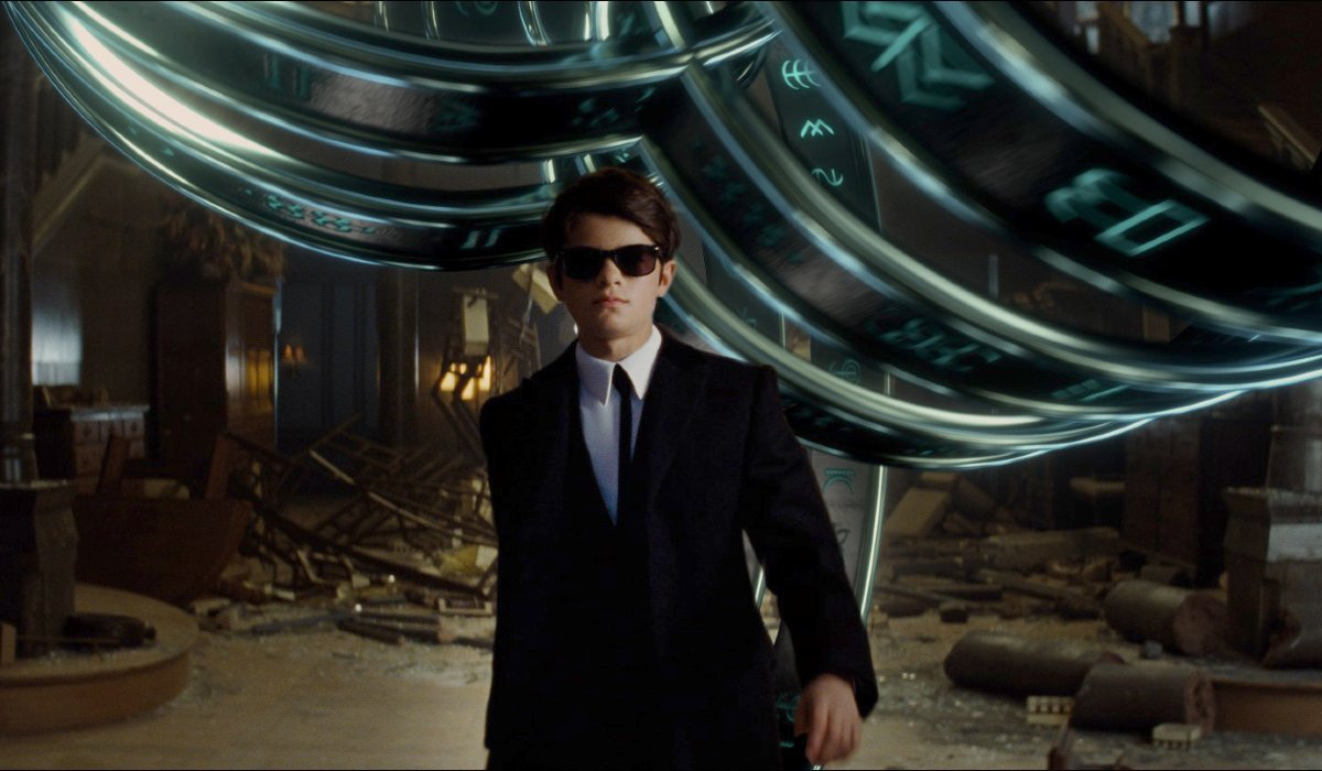 Artemis Fowl walking away from a spectacular effect