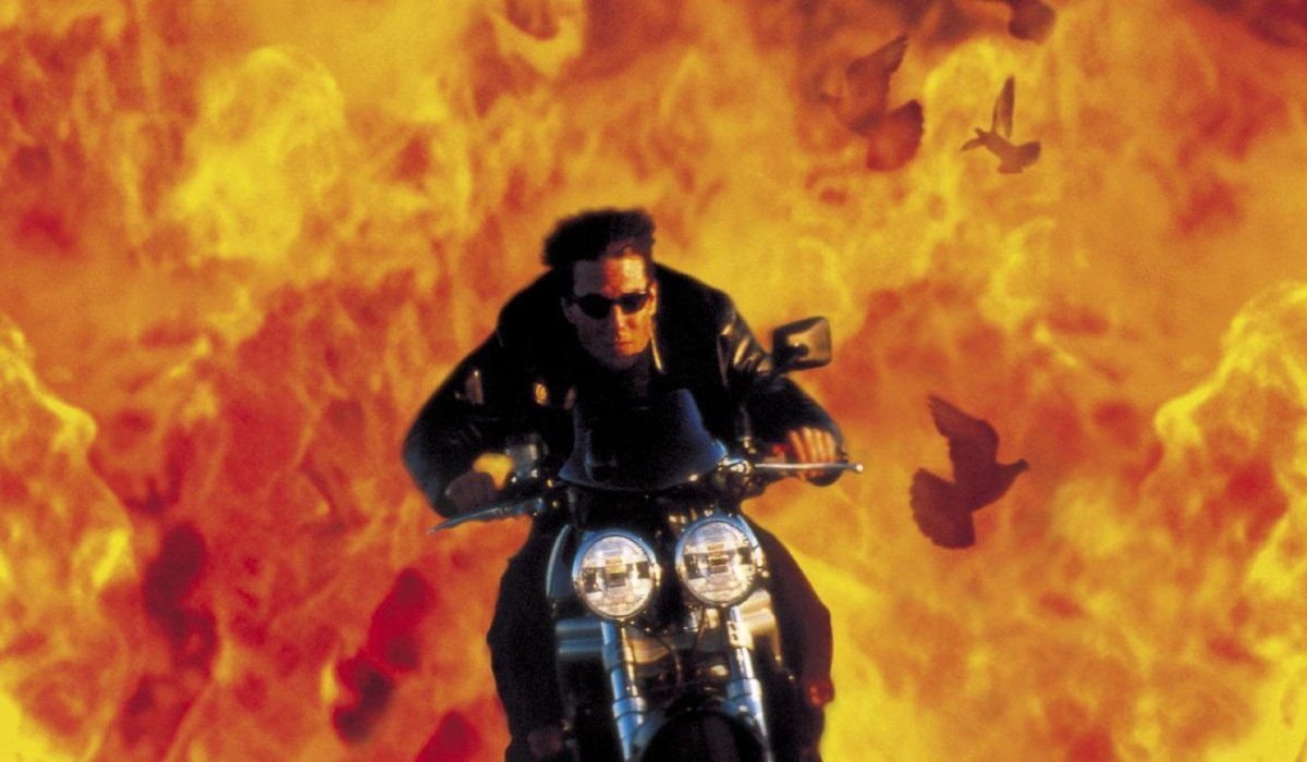 Tom Cruise riding a motorcycle out of flames in Mission: Impossible 2.