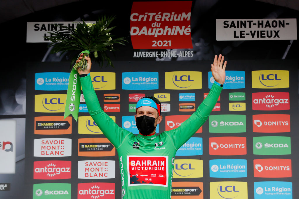 SAINT HAON LE VIEUXON FRANCE JUNE 01 Sonny Colbrelli of Italy and Team Bahrain Victorious Green Points Jersey and stage winner celebrates at podium during the 73rd Critrium du Dauphin 2021 Stage 3 a 1722km stage from Langeac to Saint Haon Le Vieuxon Trophy UCIworldtour Dauphin dauphine June 01 2021 in Saint Haon Le Vieuxon France Photo by Bas CzerwinskiGetty Images