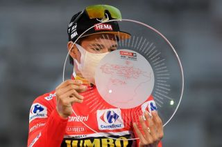 Team Jumbos Slovenian rider Primoz Roglic celebrates on the podium after winning the 2020 La Vuelta cycling tour of Spain at the end of the 18th and final stage a 1242km race from the Zarzuela racecourse to central Madrid on November 8 2020 Photo by OSCAR DEL POZO AFP Photo by OSCAR DEL POZOAFP via Getty Images