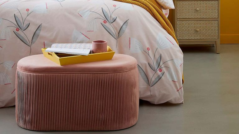Dunelm's Eloise Velvet Pleated Storage Ottoman in pink in bedroom at bottom of bed